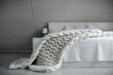 White nordic bedroom interior with knit plaid - 140074433