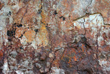 The decayed and rusted steel wall.