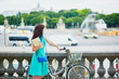 Woman riding a bicycle on a street of Paris