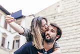 Loving young couple hugging take selfie in the historic city center of Florence, Tuscany