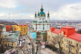 Kiev areal view with Saint Andrew's Church and historic Podil neighborhood.The Saint church is a major Baroque church designed by the Italian architect Rastrelli located in Kiev, Ukraine capital city.