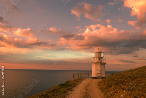 Poster Koraal Evening Landscape with Lighthouse