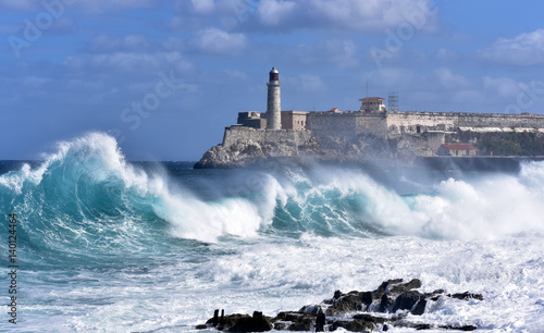 Waves breaking near the Malecon with Morro Castle in the background, Havana, Cuba