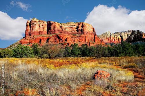 Foto op Canvas Arizona Mountain landscape Sedona Arizona, autumn foliage, iron oxide cliffs, blue skies and billowing white clouds