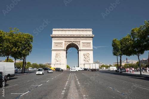 Arc De Triomphe Front Street View with Car Traffic in Paris, France. Horizontal