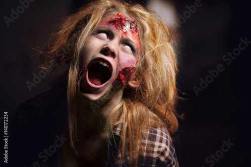 Poster Zombie girl. Girl with a broken face.