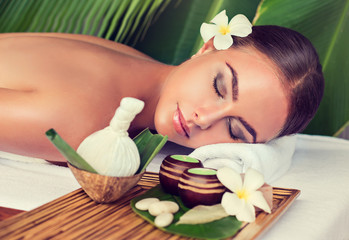 Body care. Spa body massage treatment with hot  herbal ball for deep relaxation . Woman having massage in the spa salon  © Sofia Zhuravetc