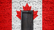 Canada flag on brick wall. Closed door in a wall