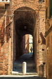 Old alleyway in Siena, Tuscany, Italy.
