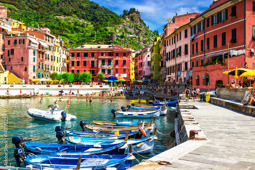 Poster View of the boats and old Vernazza village, Cinque Terre, Italy.