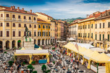 Central historic square - Piazza Giacomo Matteotti in Sarzana town, Italy. People celebrate the local food fair.