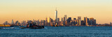 Fototapeta Panoramic Sunset of Lower Manhattan and New York City Harbor with Financial District skyscrapers and passing tugboat
