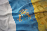 colorful waving national flag of canary islands on a euro money banknotes background.