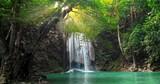 Majestic waterfall and beautiful tropical nature with sun light shining through tree branches in Erawan national park, Kanchanaburi, Thailand - 140198076