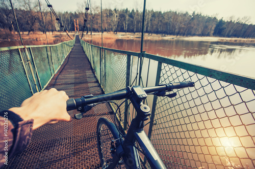 Man riding on a bicycle near the lake
