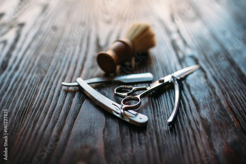 Poster Shaving and barber equipment on wooden background