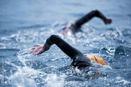 Papiers peints Nautique motorise Group of unknown Swimmers at sea.