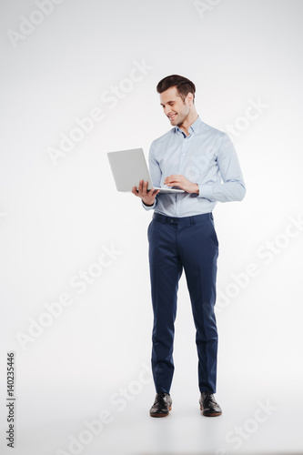 Vertical image of business man using laptop
