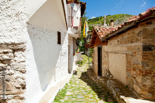 KASTORIA, GREECE - JUNE 02, 2016: photo of one of cozy street somewhere in sunny and warm Greece