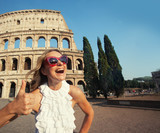 Woman on the background of the Colosseum