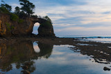Large Natural Bridge Reflected in Low Tide Pools on Neil Island in the Andaman Islands of India