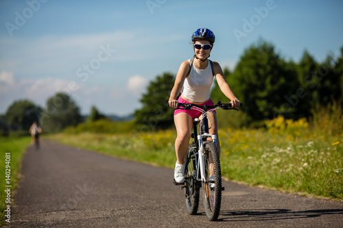 Poster Young woman cycling outdoor