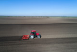 Tractor harrowing soil in spring