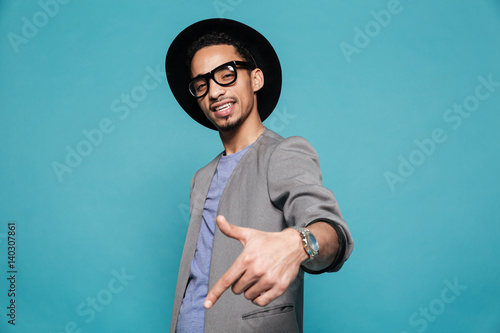 Portrait of an afro american man in eyeglasses and hat