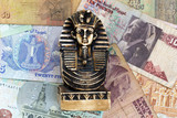 Souvenir sculpture of the Egyptian pharaoh on the money background