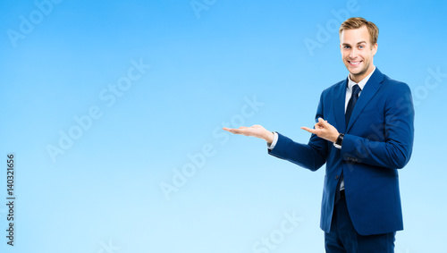 businessman showing something or copyspase