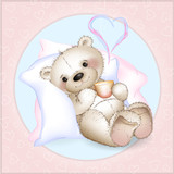 A bear lying in bed on pillows. In the hands holding a mug of milk