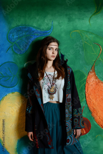 girl hippie posing with a young, hippie atmosphere