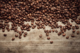Fototapety Roasted coffee beans on linen fabric
