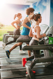 Friends Running On Treadmills At The Gym