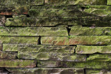 Old stone wall covered with moss