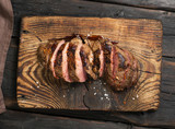 Grilled Steak on cutting board on dark background