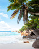 Beautiful tropical  sand beach with granite rocks and coconut palm trees. Beach Anse Cocos, La Digue, Seychelles. - 140436875