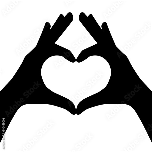 Hands making or formating a heart symbol silhouette