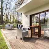 Wooden porch with chairs - 140490639
