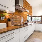 Brick wall in modern kitchen - 140490641