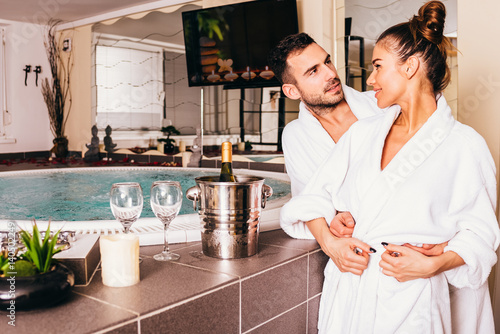 Loving couple in spa center Poster