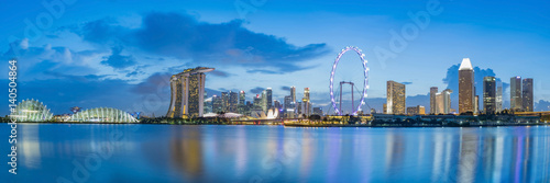 Singapore business district skyline at Marina Bay on twilight time Poster
