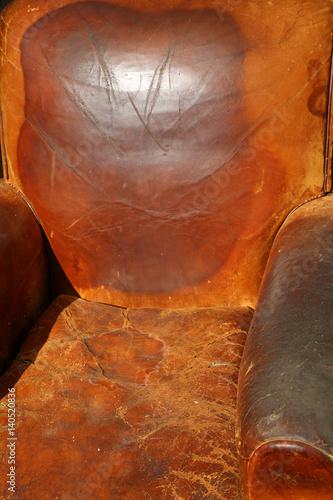leather chair broken on sale in vintage antique shop Poster