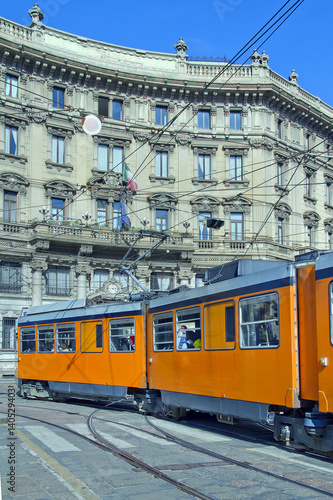 Poster tram  arancione in piazza cordusio a milano lombardia italia europa