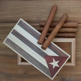 Studio scene of Cuban cigars and vintage cigar box on old wooden table.