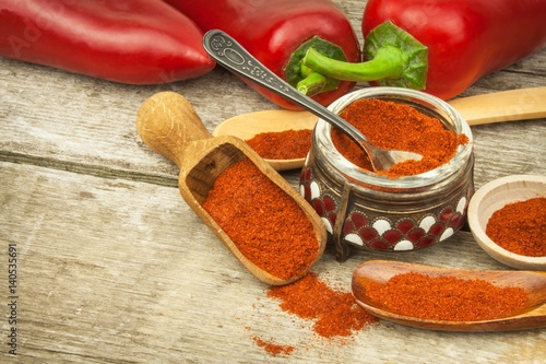 Dried red pepper. Traditional spices. Kitchen table with dried and fresh pepper. Seasoning food.