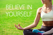 Young woman meditates while practicing yoga. Freedom concept. Motivation text believe in yourself