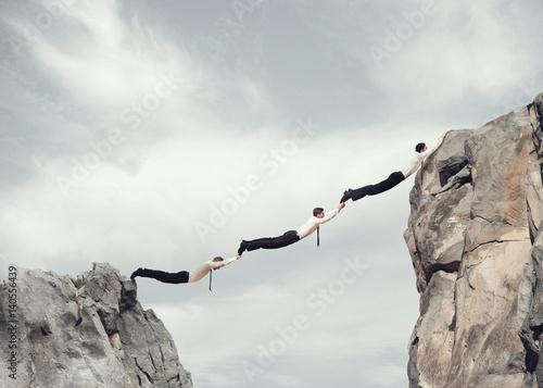 Poster Businessmen bridge working together