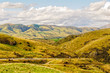 View of barren hills under clouds from Lindis Pass in Central Otago on the South island of New Zealand