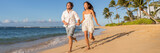 Happy couple relaxing running together on beach. Young multiracial people having fun during sunset on tropical vacation. Summer travel destination.